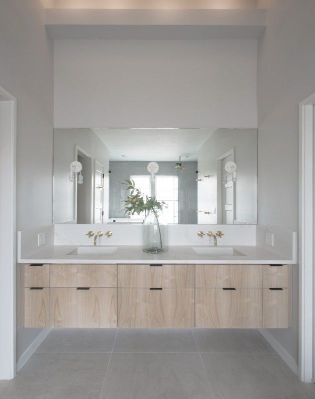 Simple bathroom design with Frost Carrina countertops to have a minimalistic tone. Check out the giant mirror to! Designer Spotlight | Fowlkes Studio - The Interior Collective
