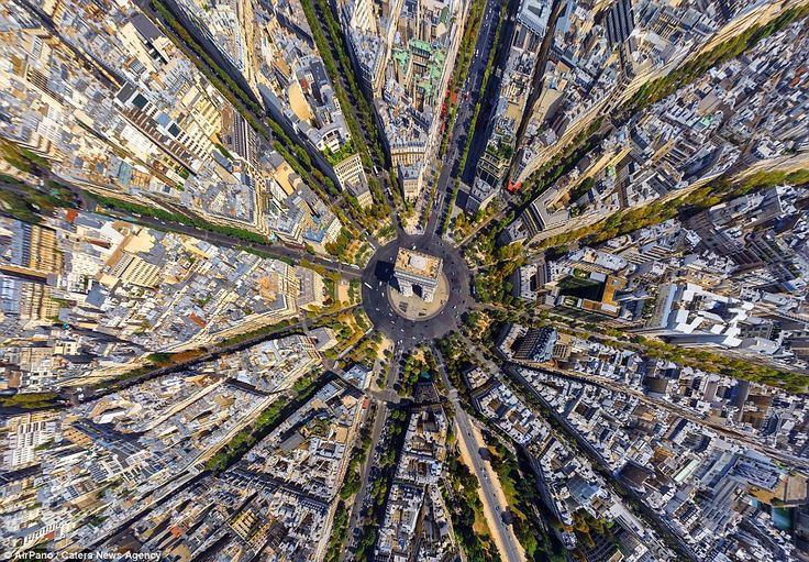 New perspective! It could confuse at first, but this is actually the Arc de Triomphe in Paris, photographed entirely from above