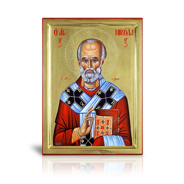 Ο ευλογών επίσκοπος των Μύρων της Λυκίας, όπως φαίνεται και στην αγιογραφία εικονίζεται φορώντας την αρχιερατική στολή του. Πρόκειται για χειροποίητη αγιογραφία της σχολής του Πανσέληνου, κατασκευασμένη πάνω σε φυσικό ξύλο με αυγοτέμπερα και φυσικά χρώματα σε σκόνη. - The blessing bishop of Myra is depicted wearing his liturgical vestment. This handmade work of Byzantine art, created by the hagiography school Panselinos, was painted on natural wood with tempera.