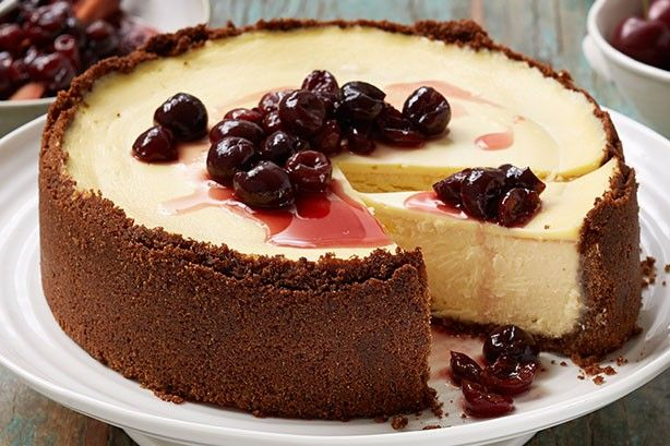Curtis Stone's decadent cheesecake is served with perfect boozy cherries - a celebration of the fruit of summer.