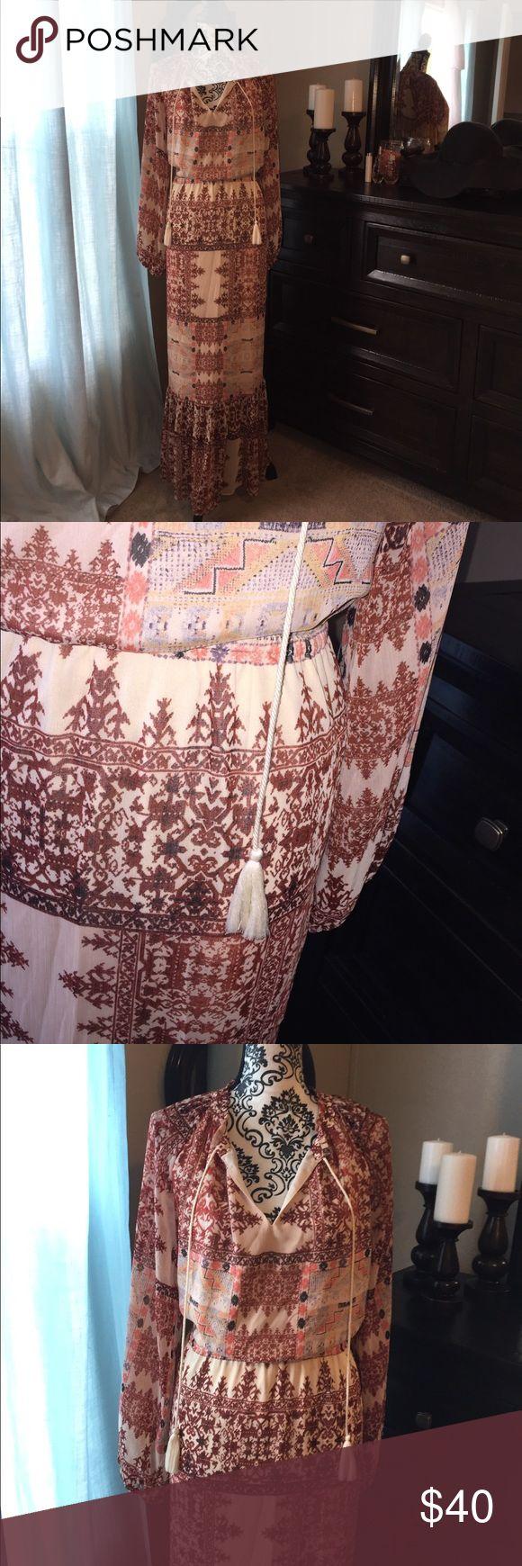 Boho Dream Dress!! Cream & Rust Tribal Maxi Dress Size XL. Lined to mid calf. Elastic Waist. Tassel neck. Ruffled hem. Boho chic. Tribal and floral print. Dresses Maxi