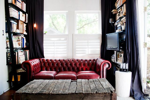 For a teeny tiny living room, sneak shelves in on each side of the sofa