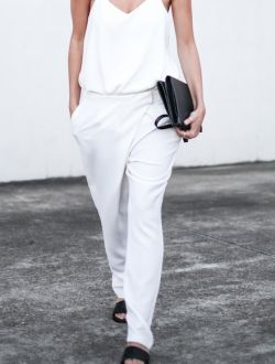 A silk cami and slouchy trousers worn with sliders and a clutch is an effortlessly chic outfit for a laidback spring night out as seen on What Do I Wear?