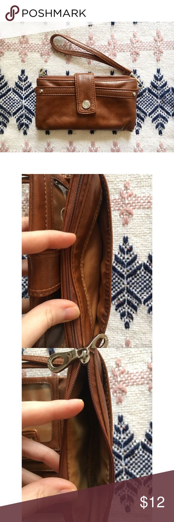 Faux Leather Wallet Wristlet // Perfect faux leather wallet! Fits everything. Wrist strap can be taken off completely or used for keys/keychains. Has card slots w/ one clear slot, three money pockets, an outer change purse compartment with a zipper and another outer pocket. Button closure like a clutch. American Eagle for exposure. Well-loved with gentle wear. 🌞🌻 American Eagle Outfitters Bags Wallets