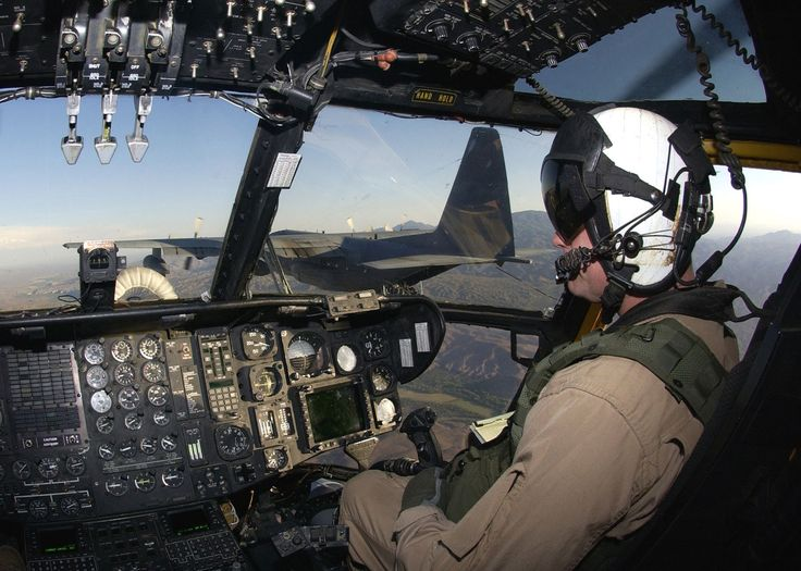 View of the CH-53E's cockpit during an in-flight refueling operation with an Air Force HC-130 Hercules