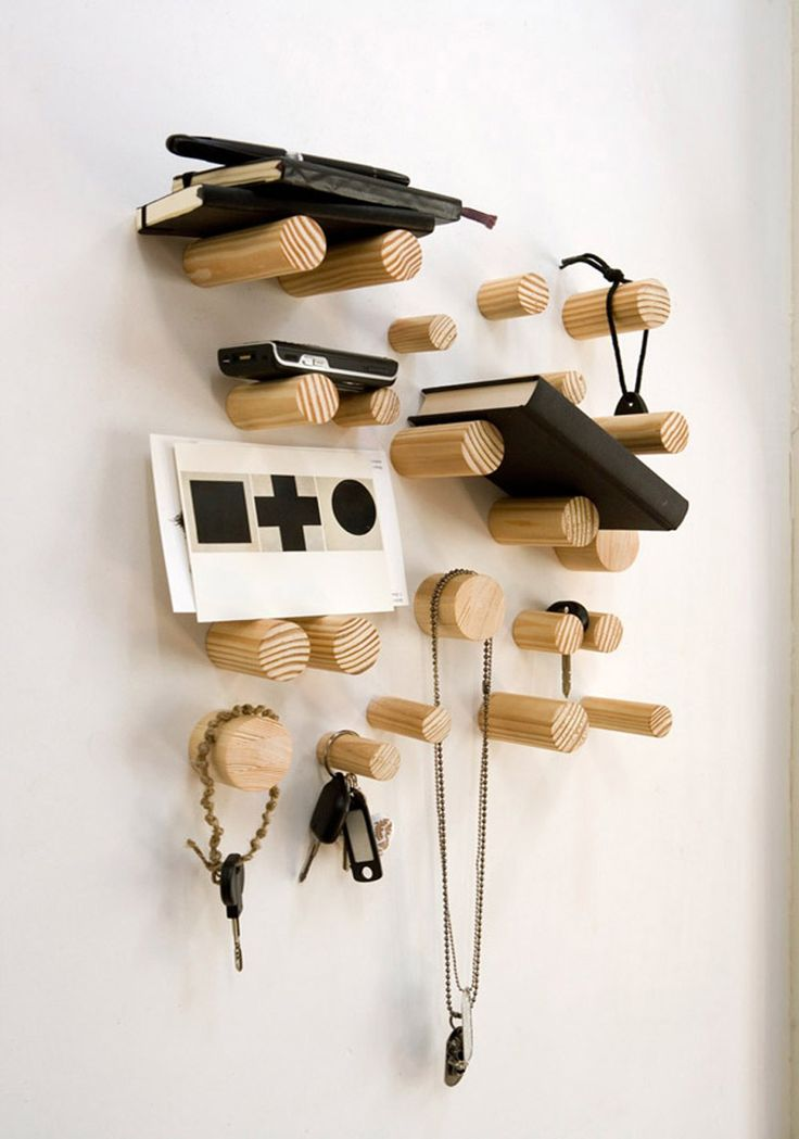 I love the idea of something like this instead of a coat rack.  However, won't be using it to stack my crap on the wall.