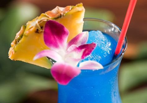 Blue Hawaiian ; 1 oz light rum, 1 cherry, 2 oz pineapple juice, 1 oz Blue Curacao liqueur, 1 oz cream of coconut, 1 slice pineapple ; Blend light rum, blue curacao, pineapple juice, and cream of coconut with one cup ice in an electric blender at high speed. Pour contents into a highball glass. Decorate with the slice of pineapple.