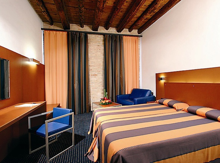 Hotel Residenza Cannaregio Venice | The Guestrooms Are The Interplay Of Stone, Burnished Iron, Wood, Natural Textiles In Soft Colours And Modern Furniture | View All Popular Hotels in Venice!