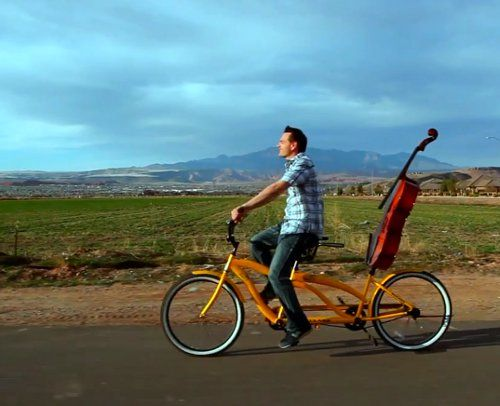 bike. Cellist Steve Nelson of The Piano Guys rides a tandem bicycle with his beloved cello.