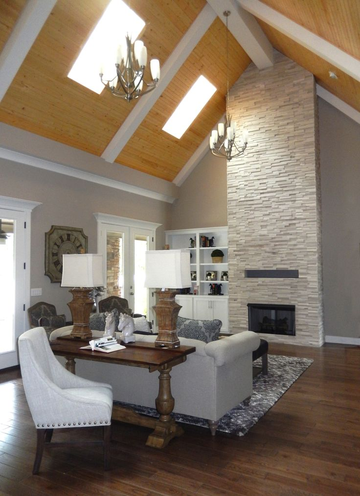 white birch realstone tile two story fireplace silver dollar porter paint wall