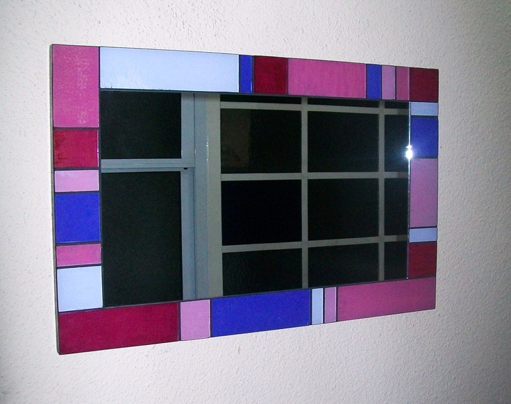 Espejo artesanal con marco de vidrio