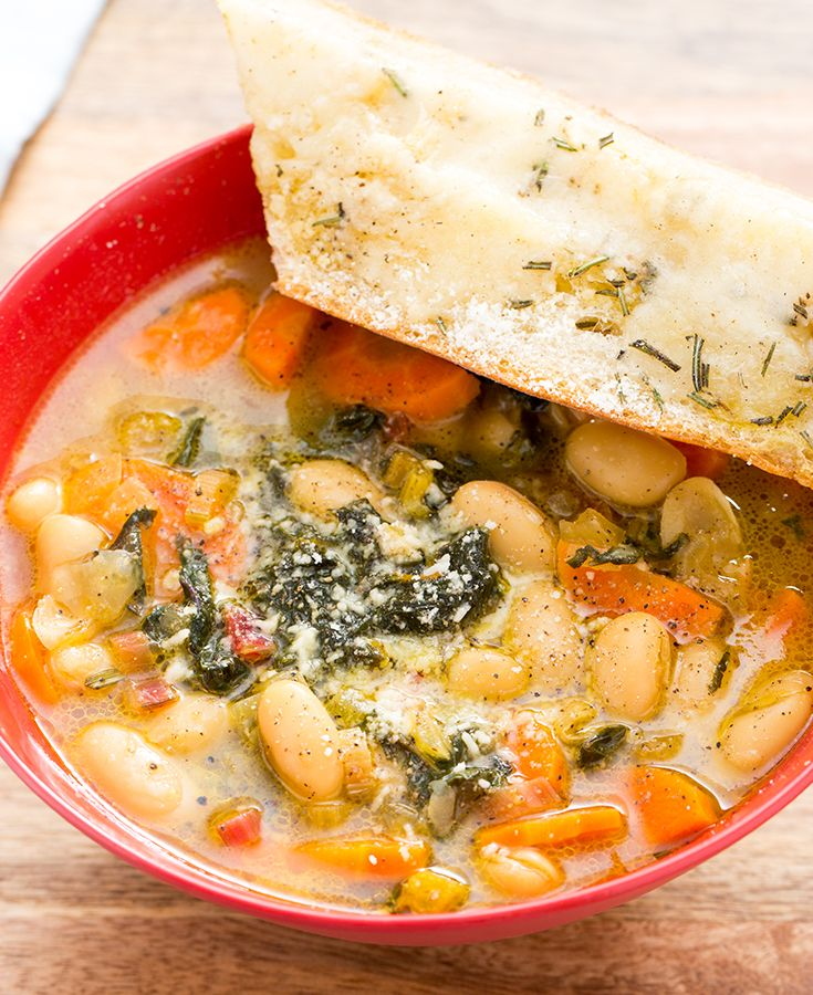 A hearty bean soup with a side of rosemary toast.