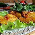 Картофель, запеченный в помидорном соусе