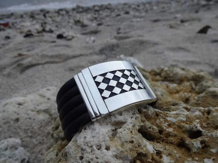 Timeless & handmade jewellery made from 5 bands of black genuine rubber & 925S. Suitable for woman or man. kayan@indo.net.id Whatsup: +62 (0) 81238110039
