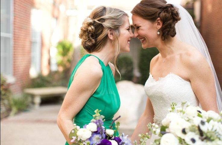 the bride and her maid of honor share a sweet moment before the ceremony!