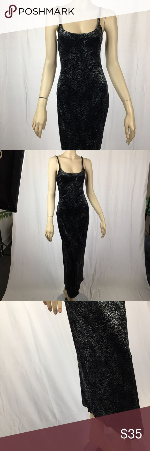 Betsey Johnson Velvet Gray & Black Leopard Maxi Vintage Betsey Johnson Velvet Gray & Black Leopard Print Maxi Dress with Lace bottom hem. Perfect condition. Very sexy. Made in USA. 64% Acetate, 26% polyamide, 10% elastic. Spaghetti straps. Size medium. Measurements: 50 inches long, 28 inch bust, 24 inch waist. Stretch material so these measurements have some wiggle room. Pattern has a brownish hue to it in certain lighting Betsey Johnson Dresses Maxi