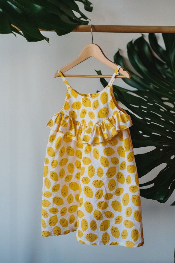 L i m o n c e l l o . D r e s s Zesty and full of summer fun this dress is the perfect outfit for beach or play. Made from the softest silky voile in super fun lemon print. Button closure at back and frill at the yoke. Also available in a top! Each Charlie Bird order arrives in brown paper packaging tied up with string S i z i n g . a n d . F a b r i c s Available in sizes 6mths-6yrs. 100% Cotton voile. Fabric has been pre washed. Spot clean with damp cloth or gentle machine wash in cold…