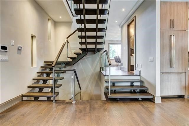 Modern Stair Case, Stainless Steel and Glass Railings. Stained Oak Treads