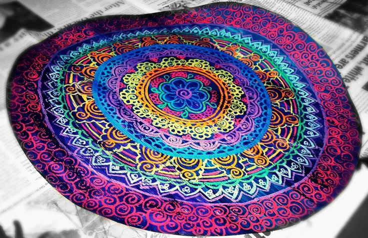 It's called a mandala. Used crayons to make the pattern on paper and painted food colouring over