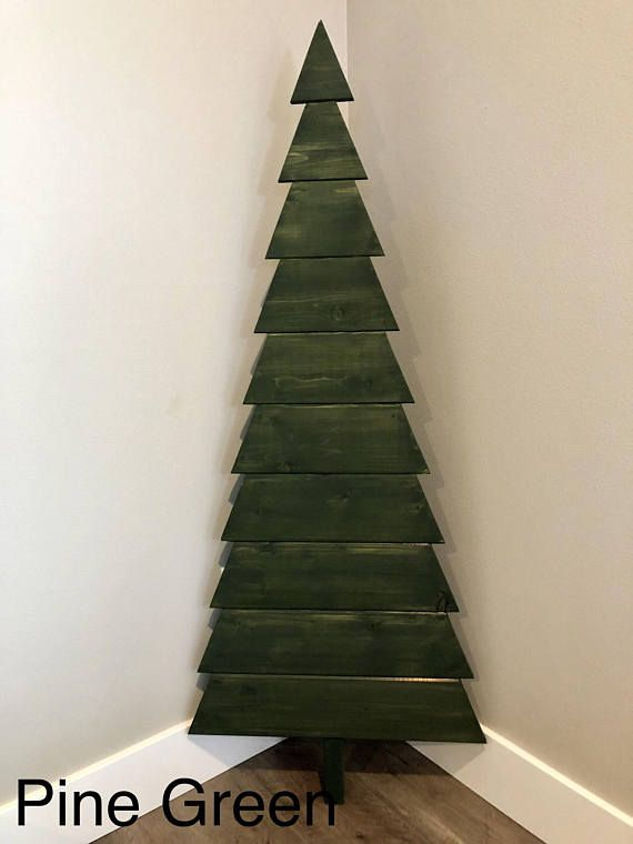 Handcrafted wood Christmas tree, made from reclaimed pine wood. These trees are beautiful displayed on the front porch during the holiday season and all year long. They can also be decorated with lights, twine and ornaments or clothes pins to hang photos. - made by hand - hand sanded,