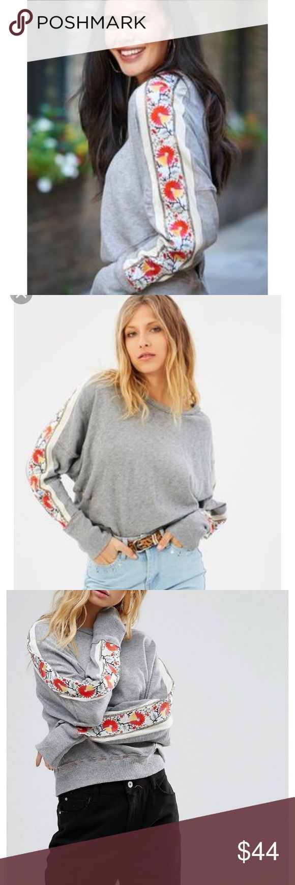 Free People Wall Flower Sweatshirt in Grey Sz S Excellent Condition, worn 1x. Simple grey sweatshirt embellished with a beautiful, bright floral striped down each sleeve in Cropped, cinched waist. Dolman/batwing style sleeves. Crewneck. Doesn't run oversized, true Sm. Free People Tops Sweatshirts & Hoodies