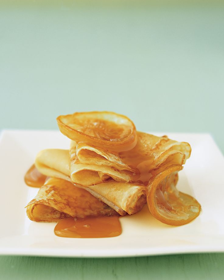 In this dish, paper-thin pancakes are topped with slices of candied lemon and drizzled with a caramel sauce that includes limoncello, a vibrant lemon liqueur.