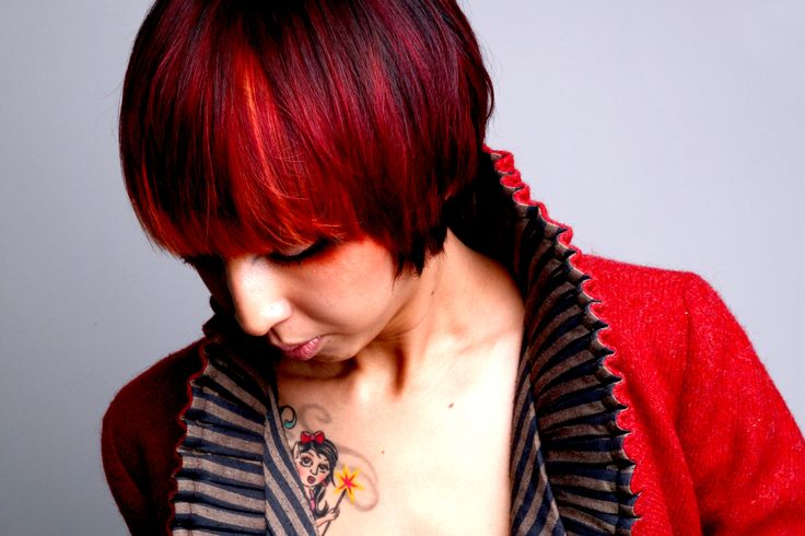 Heavy fringe bob cut with red and copper peekaboo highlights. By Rachel Walker www.chillicouture.com.au