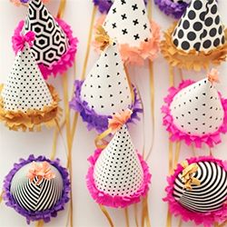 Check out this colorful birthday party with tons of crafty ideas. Including a handmade party backdrop and party hats.