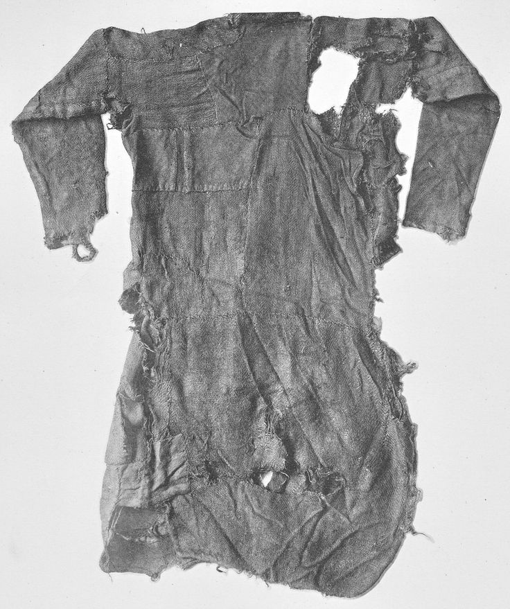 Bernuthsfeld tunic/shirt back - 680–775 CE Denmark (today Germany)  His heavily worn tunic was patched out of 45 single pieces of cloth, out of 20 different fabrics in 9 different weaving patterns!