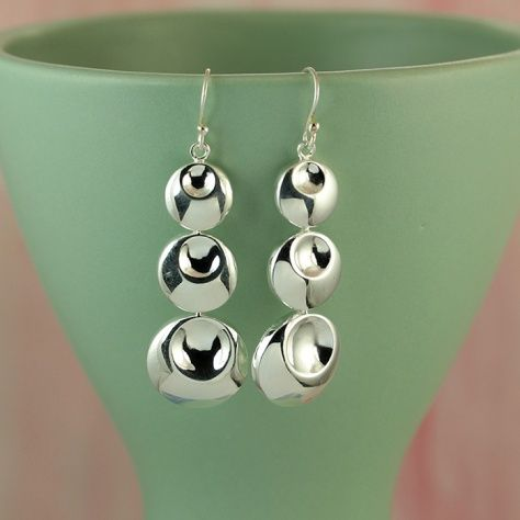 Eclipse Earrings £35.00 These stunning silver earrings has sculpted to catch the light just right All of our silver jewellery comes packaged in a pretty gift box.  Sterling Silver  Size: 15 X 55 mm Drop