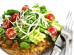 California Pizza Kitchen's Chicken Caesar Salad Pizza Made Skinny...I love to remake many of the recipes at California Pizza Kitchen. This skinny remake isn't on their menu anymore but comes from one of their cookbooks. I'm using a whole wheat pita for the crust, reduced-fat Caesar dressing, reduced-fat cheese and adding fresh tomatoes to the salad.  One serving has 379 calories, 15 grams of fat and 9 Weight Watchers POINTS PLUS.  It's taste amazing!