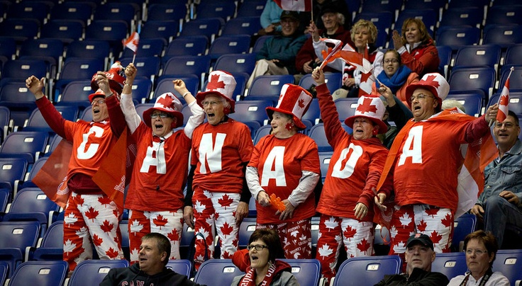 Curling fans cheer on Canada skip Brad Jacobs and his team during their game against Norway at the World Men's Curling Championships in Victoria, British Columbia April 2, 2013. REUTERS/Andy Clark