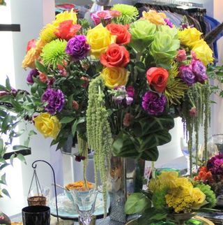 """Read: """"How to Make 8 Unusual Place Settings For A Fantasy Tablescape""""  Image: www.flymetothemoonflorists.com #diy flowers #flowers #centerpiece"""