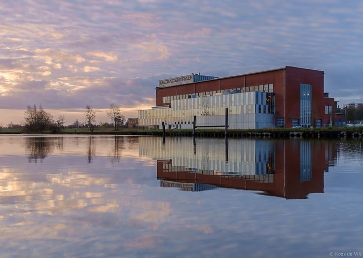 https://flic.kr/p/D2ZRmk | Mediacentrale at sunrise | The Mediacentrale used to be the electric power plant for the district Helpman in Groningen and was in use until 1984. After that it is completely rebuilt (inside) and from 2005 on this is a big office building for Media and Internet companies.  Dutch info:  nl.wikipedia.org/wiki/Mediacentrale_(Groningen)  Taken in Groningen, The Netherlands.  © Koos de Wit All rights reserved. Please don't use this image without my permission…