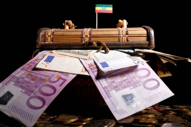 ethiopian flag on top of crate full of money