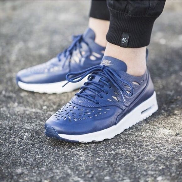 Nike Air Max Thea Joli midnight navy Nike midnight navy leather Air Max theas with laser cut details.  Women's size 7  NEW with box. Nike Shoes Sneakers