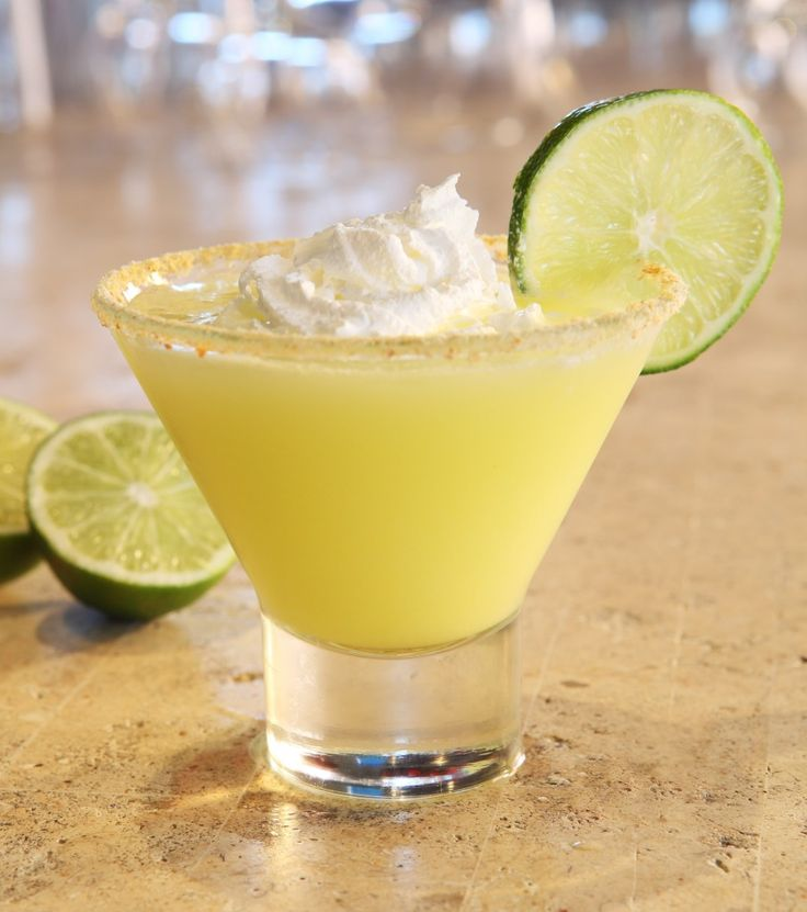 Key Lime Martini    (Squeeze of half a lime    1 oz. Ciroc Coconut Vodka    1 oz. Pinnacle Whipped Vodka    .5 oz. pineapple juice    .25 oz. cream of coconut    Crushed graham cracker, whipped cream, and lime slice for garnish)