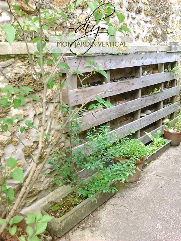 Jardin vertical et mural fait avec une vieille palette - Jardin vertical palette ...