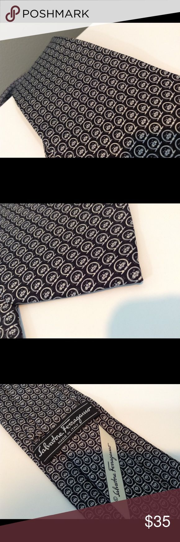 Salvatore Ferragamo Necktie with Cat Face Design Salvatore Ferragamo necktie, black background with repeating design of tiny cat faces (or some other cute animal with whiskers). Made in Italy of 100% silk. Measures 56 in long x 3 3/8 at widest spot. Excellent condition. Ferragamo Accessories Ties