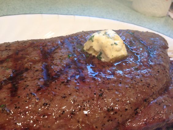 Grilled london broil with compound butter
