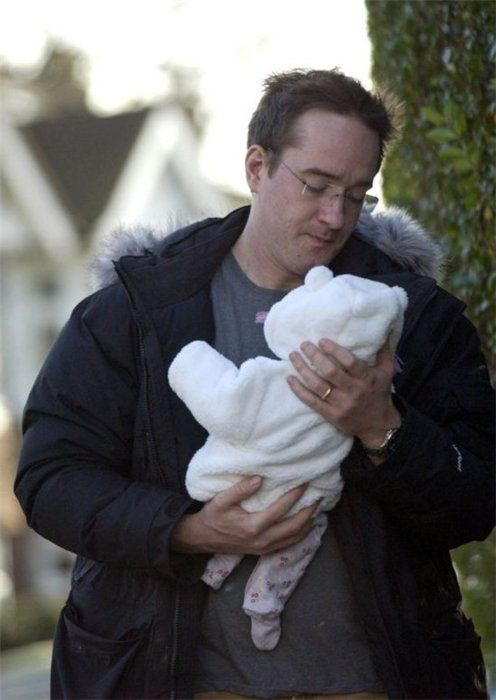 ,Mathew holding his daughter Maggie. HERMOSO!!!!!!