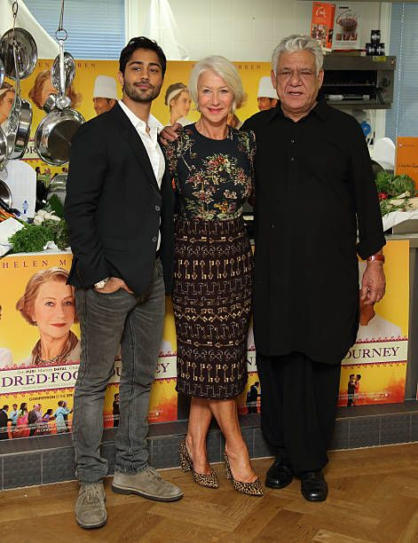 Helen Mirren Om Puri and Manish Dayal attend a photocall for 'The Hundred Foot Journey' at Le Cordon Bleu on September 2 2014 in London England