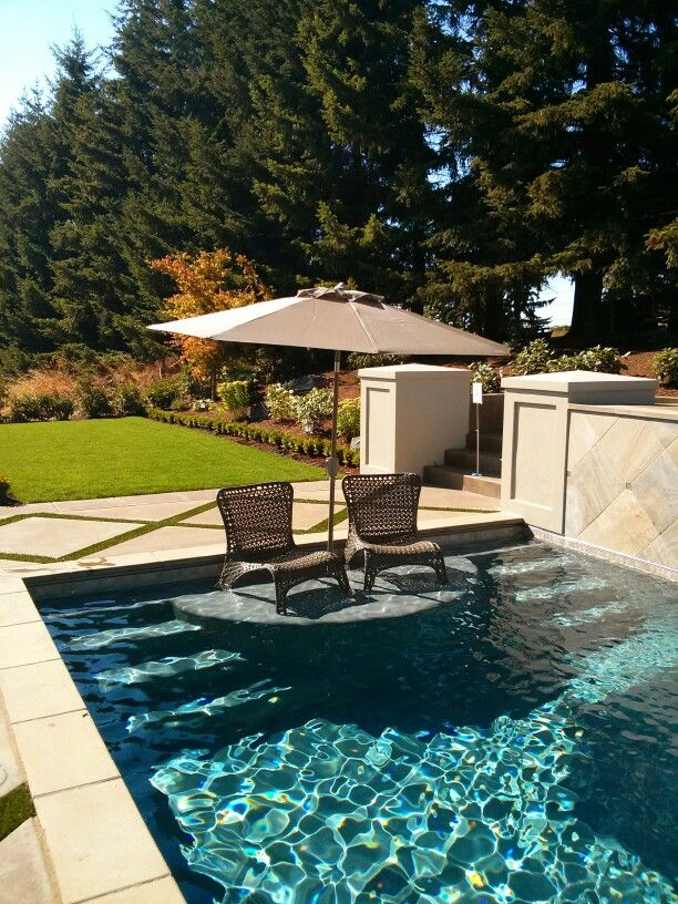 A sitting area IN the pool - what a great idea!