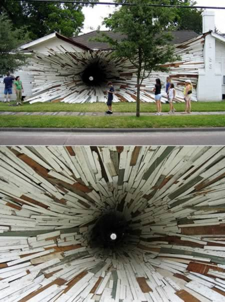 """Houston artists, Dan Havel and Dean Ruck, turned them into an art installation known as """"Inversion."""" Using boards from the outside of the houses they created a large funnel-like vortex running between the two that ends in a small hole in an adjacent courtyard."""