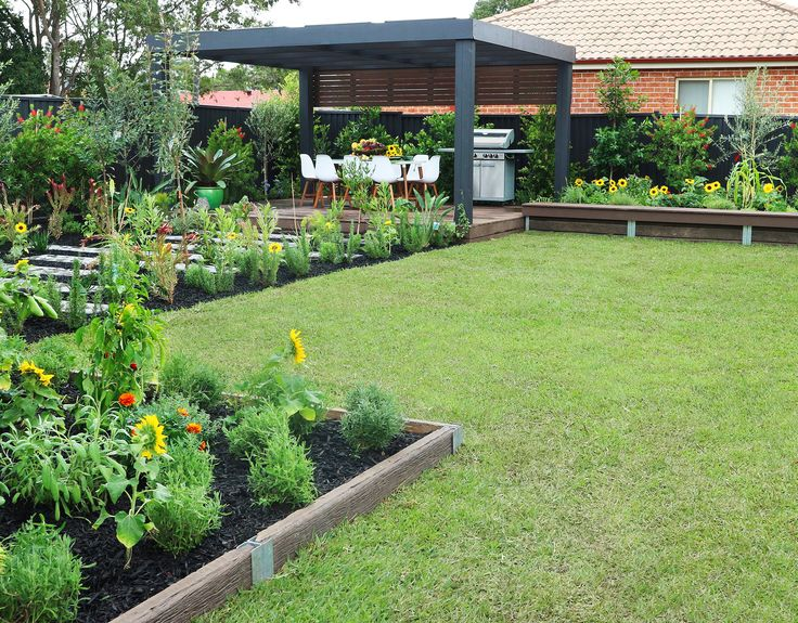 See how Jamie Durie transformed this suburban backyard into a garden made for entertaining complete with a pergola and dining area plus an array of vegie, fruit and herb plants. Story: homes+