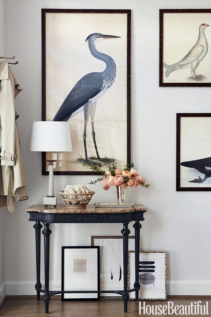 Mahogany demilune with black framed art display.