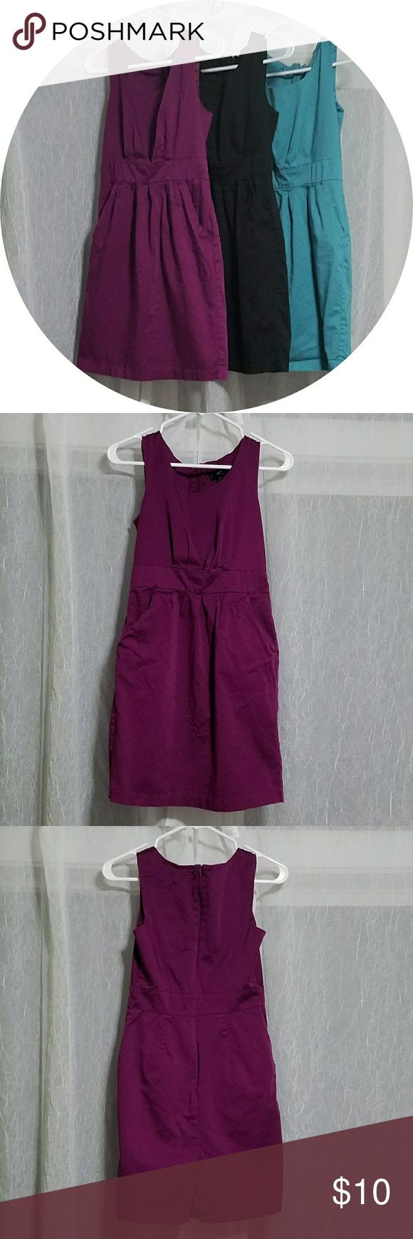 Purple Mossimo dress Purple Mossimo dress, size 2. This is a great, versatile dress that would be suitable for work or going out. It is zip-up in the back, has pockets, and an interior lining.  Interested in the other colors too? Check them out in my closet, and bundle to save! I bought these off Poshmark being hopeful they'd fit me (I wear a size 4), but they are too small for me. Mossimo Supply Co. Dresses