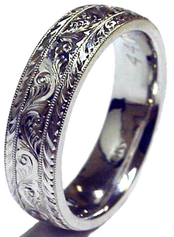Specification:  6 mm solid 14K White Gold ring Hand Engraved traditional pattern finish Comfort Fit inside. Jewelry Item # : 4401-ESY-3  Description: Mens