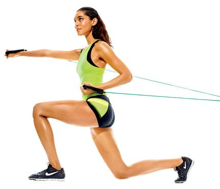 Resistance Band Workout: Work shoulders, triceps, biceps, butt and thighs with 'Power Punch.' Anchor center of band at hip height. Stand with back to anchor, holding handles at hips, elbows bent, palms up. Lunge left leg forward as you punch with right hand (as shown); repeat on opposite side for one rep. Do three sets of 12 reps. #SelfMagazine