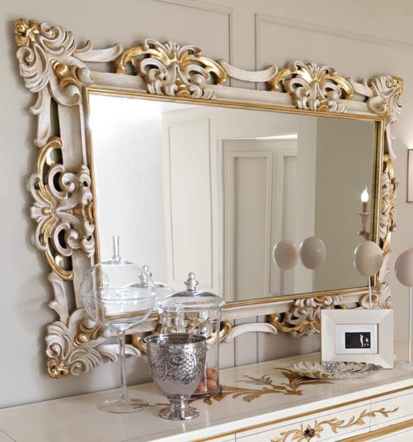 Paris collection gold and white wall mirror shown here with the frame finished in a destressed antique white with gold leaf detail. A real statement piece for any wall. Made to a high standard being carved from solid walnut wood.